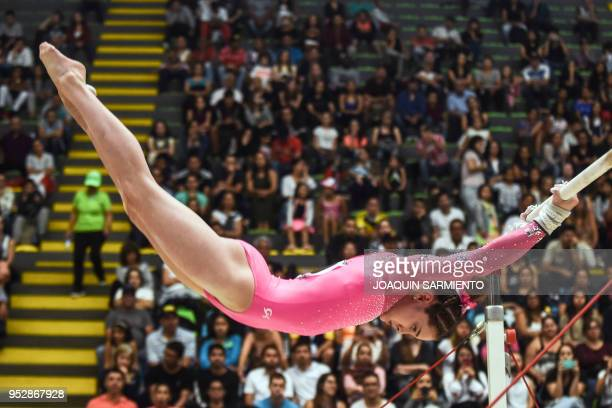 TOPSHOT Jordan Bowers from the United States competes on the uneven bars during the final day of the 2018 Pacific Rim Championships in Medellin...