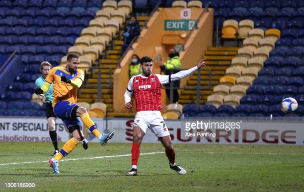 Jordan Bowery of Mansfield Town scores their sides first goal during the Sky Bet League Two match between Mansfield Town and Cheltenham Town at One...
