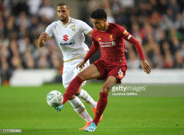 Jordan Bowery of MK Dons looks on as KiJana Hoever of Liverpool controls the ball during the Carabao Cup Third Round match between Milton Keynes Dons...