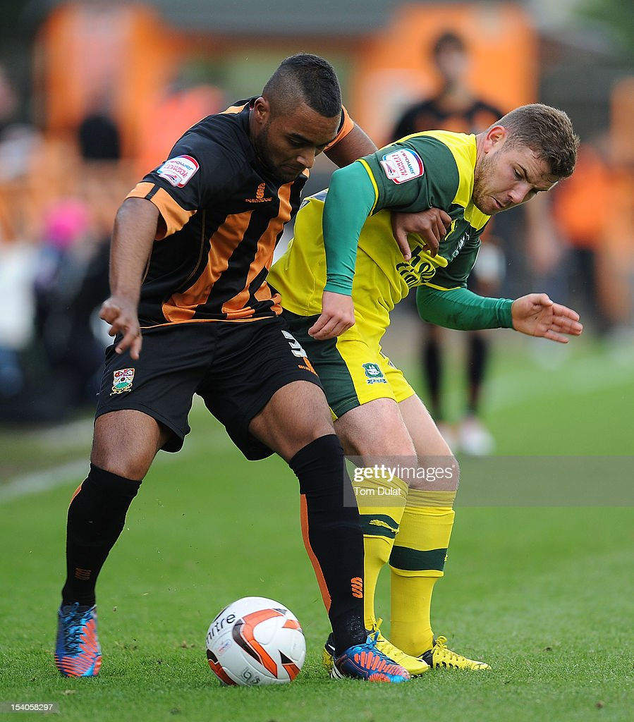 Jordan Brown of Barnet and Alex MacDonald of Plymouth Argyle battle for the ball during the npower League Two match between Barnet and Plymouth Argyle at Underhill Stadium on October 13, 2012 in Barnet, England.