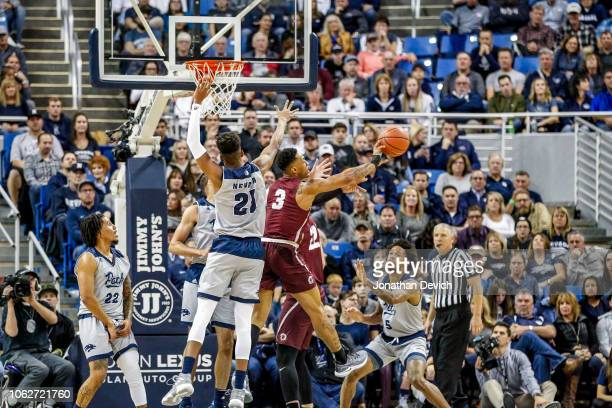 Jordan Brown of the Nevada Wolf Pack goes after the ball as Rayjon Tucker of the Arkansas Little Rock Trojans gets the rebound at Lawlor Events...