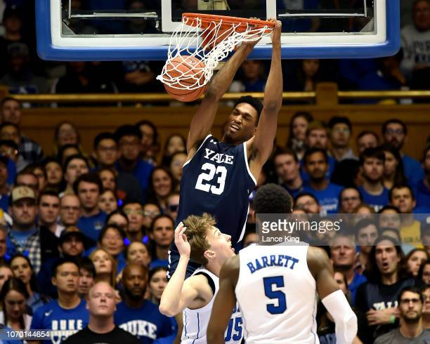 Jordan Bruner of the Yale Bulldogs dunks the ball against Alex O'Connell and RJ Barrett of the Duke Blue Devils in the second half at Cameron Indoor...