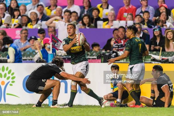 Jordan Bunce of New Zealand tries to put a tackle on Muller du Plessis of South Africa during the HSBC Hong Kong Sevens 2018 Bronze Medal Final match...