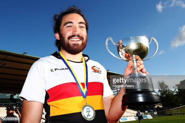 Jordan Bunce of Waikato celebrates with the player of the tournament trophy after winning the Bayleys National Sevens Men's Cup Final match between...