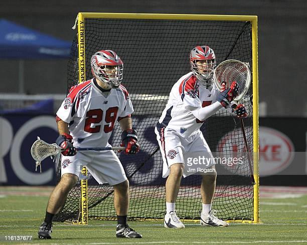 Jordan Burke and JJ Morrissey of Boston Cannons defend against the Long Island Lizards at Harvard Stadium on June 11 2011 in Boston Massachusetts
