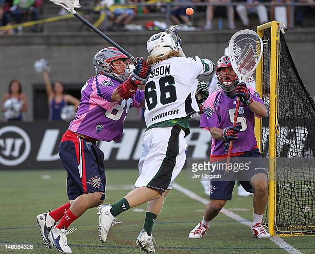 Jordan Burke and Mitch Belisle of the Boston Cannons defend against Matt Gibson of the Long Island Lizards in the first period at Harvard Stadium...