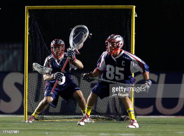 Jordan Burke and Mitch Belisle of the Boston Cannons defend the net against the New York Lizards at Harvard Stadium on June 21 2013 in Boston...