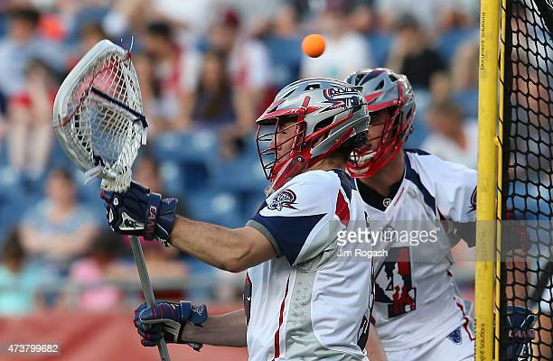 Jordan Burke of Boston Cannons allows a goal by Jordan Wolf of Rochester Rattlers in the second period at Gillette Stadium on May 17 2013 in Foxboro...