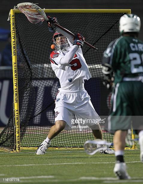 Jordan Burke of Boston Cannons defend defends the net against the Long Island Lizards at Harvard Stadium on June 11 2011 in Boston Massachusetts