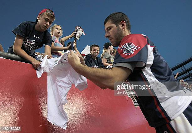 Jordan Burke of Boston Cannons signs autographs after a game with the Ohio Machine in the second half at Gillette Stadium on July 11 2015 in Foxboro...