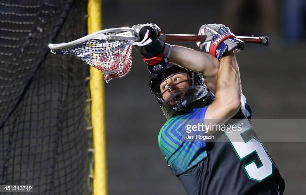 Jordan Burke of Team MLL makes a save against Team USA iduring the 2014 MLL All Star Game at Harvard Stadium on June 26 2014 in Boston Massachusetts