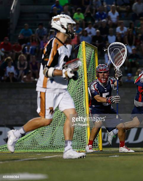 Jordan Burke of the Boston Cannons defends the net against the Rochester Rattlers at Harvard Stadium on August 9 2014 in Boston Massachusetts