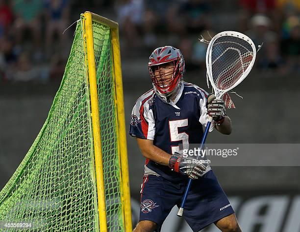 Jordan Burke of the Boston Cannons defends the nets against the Rochester Rattlers at Harvard Stadium on August 9 2014 in Boston Massachusetts