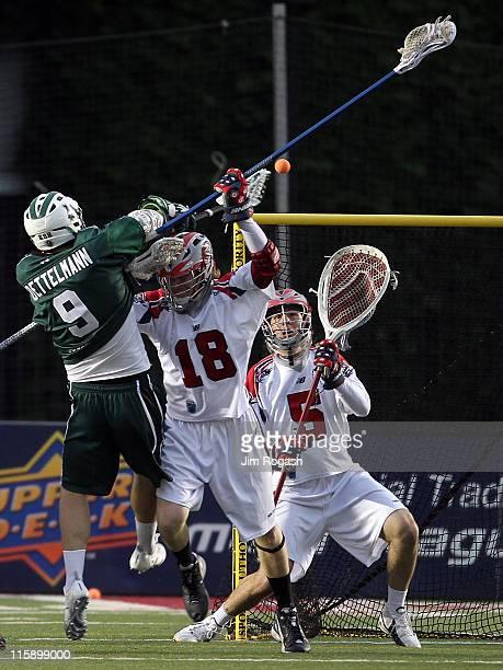 Jordan Burke of the Boston Cannons guards the net against a shot by Tim Goettelmann of the Long Island Lizards at Harvard Stadium on June 11 2011 in...