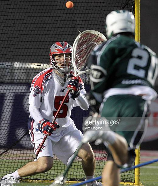 Jordan Burke of the Boston Cannons guards the net against the Long Island Lizards for control of the ball at Harvard Stadium on June 11 2011 in...