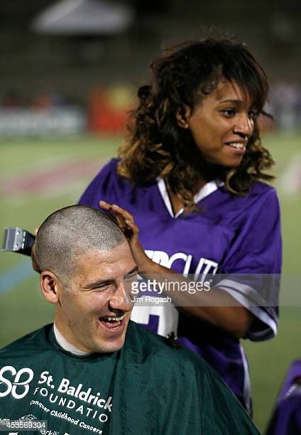 Jordan Burke of the Boston Cannons has his head shaved for a charity at Harvard Stadium on August 9 2014 in Boston Massachusetts