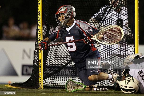 Jordan Burke of the Boston Cannons in action against the Long Island Lizards during their Major League Lacrosse game on July 16 2011 at Shuart...