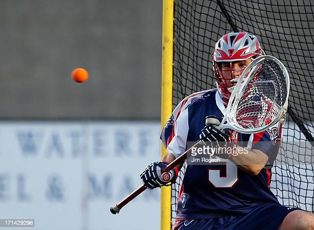 Jordan Burke of the Boston Cannons makes a save against the New York Lizards at Harvard Stadium on June 21 2013 in Boston Massachusetts