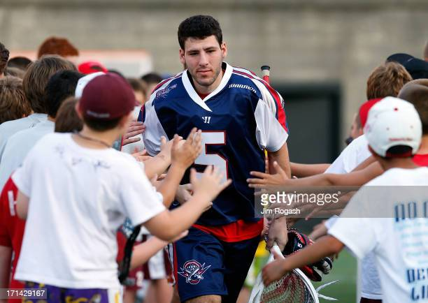Jordan Burke of the Boston Cannons runs on to the field before a game against the New York Lizards at Harvard Stadium on June 21 2013 in Boston...