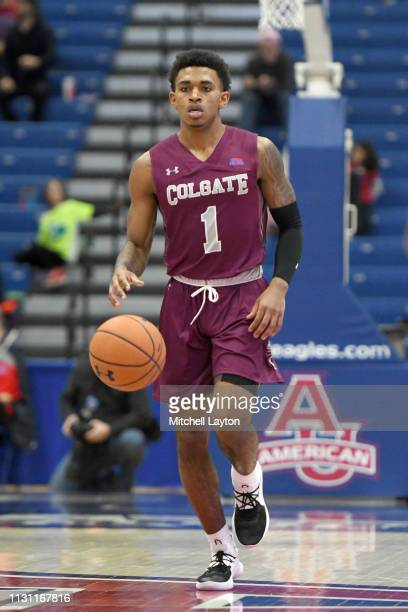 Jordan Burns of the Colgate Raiders dribbles up court during a college basketball game against the American University Eagles at Bender Arena on...