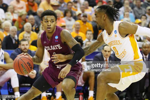 Jordan Burns of the Colgate Raiders handles the ball against Jordan Bone of the Tennessee Volunteers during the first half in the first round of the...