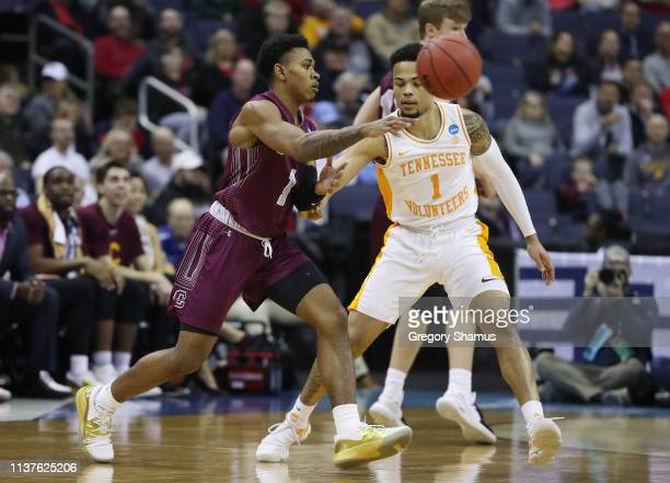 Jordan Burns of the Colgate Raiders passes the ball against Lamonte Turner of the Tennessee Volunteers during the second half in the first round of...