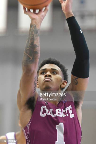 Jordan Burns of the Colgate Raiders takes a foul during a college basketball game against the American University Eagles at Bender Arena on February...