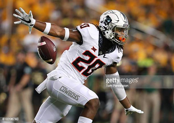 Jordan Burton of the Oklahoma State Cowboys celebrates after recovering a fumble against the Baylor Bears in the first half at McLane Stadium on...