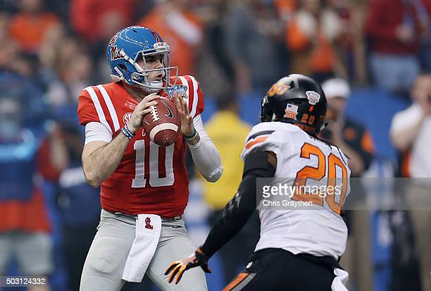 Jordan Burton of the Oklahoma State Cowboys sacks quarterback Chad Kelly of the Mississippi Rebels during the first quarter of the Allstate Sugar...