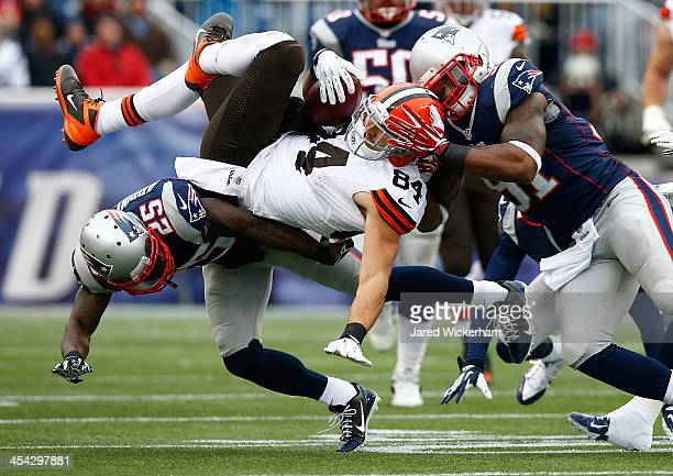 Jordan Cameron of the Cleveland Browns is upended by Kyle Arrington of the New England Patriots after catching a pass in the first quarter during the...