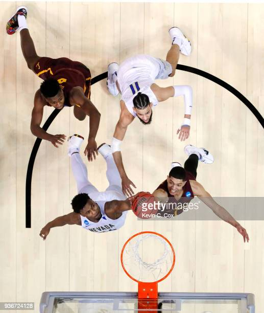 Jordan Caroline of the Nevada Wolf Pack and Lucas Williamson of the Loyola Ramblers battle for the rebound during the 2018 NCAA Men's Basketball...
