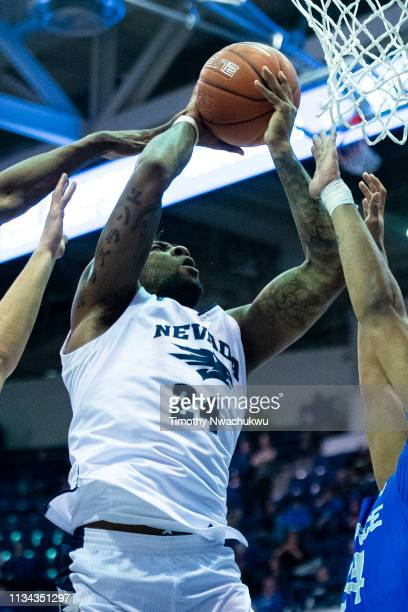 Jordan Caroline of the Nevada Wolf Pack attempts a lay up among Air Force Falcons during the first half at Clune Arena on March 5 2019 in Colorado...
