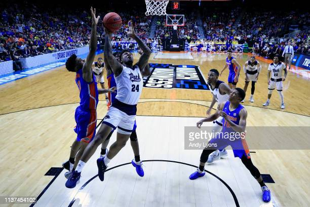 Jordan Caroline of the Nevada Wolf Pack attempts a shot against Jalen Hudson of the Florida Gators in the second half during the first round of the...