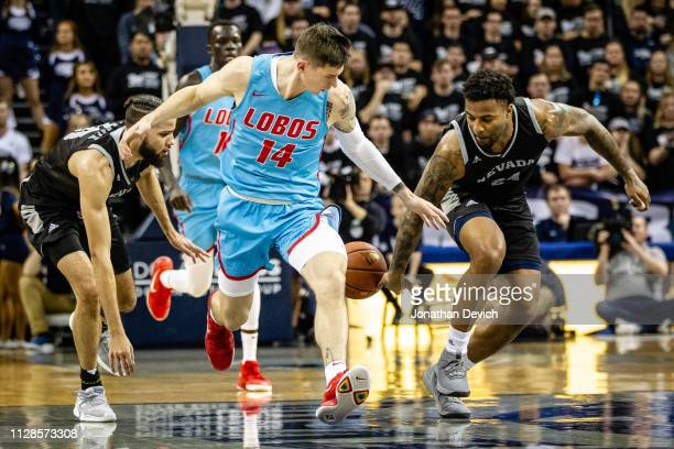 Jordan Caroline of the Nevada Wolf Pack gets the ball away from Dane Kuiper of the New Mexico Lobos as he moves down the court at Lawlor Events...