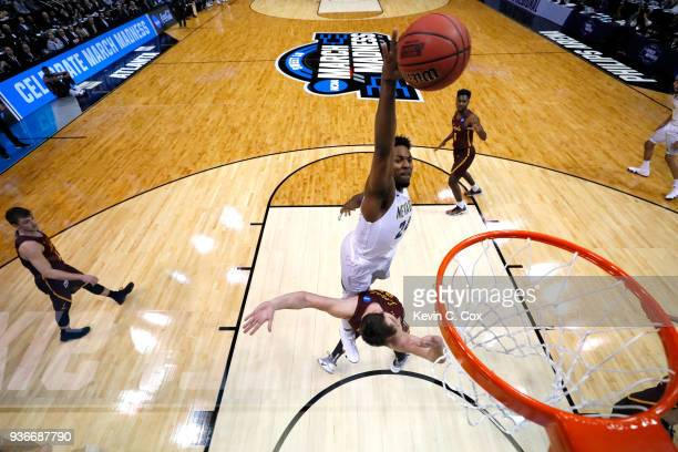Jordan Caroline of the Nevada Wolf Pack goes up for a dunk against Cameron Krutwig of the Loyola Ramblers in the first half during the 2018 NCAA...
