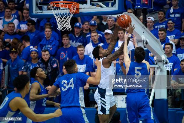 Jordan Caroline of the Nevada Wolf Pack reaches for a rebound over Chris Joyce of the Air Force Falcons at Clune Arena on March 5 2019 in Colorado...