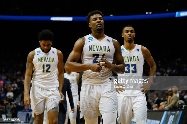 Jordan Caroline of the Nevada Wolf Pack walks off the floor with teammates after being defeated by the Loyola Ramblers during the 2018 NCAA Men's...