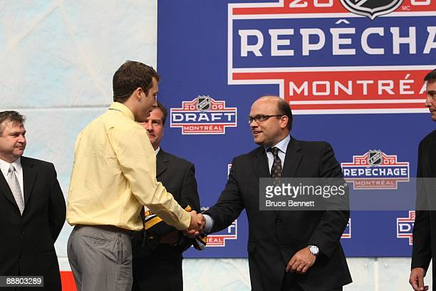 Jordan Caron shakes hands with Boston Bruins General Manager Peter Chiarelli after being drafted during the first round of the 2009 NHL Entry Draft...