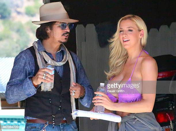Jordan Carver and Ronnie Rodriguez are seen on the movie set of 'Who Killed Johnny' on August 07 2012 in Los Angeles California
