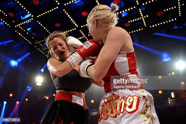 Jordan Carver fights Melanie Mueller during the 'Das Grosse Prosieben Promiboxen' tv show at Castello on September 27 2014 in Duesseldorf Germany