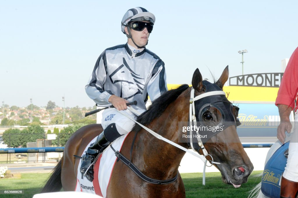 Jordan Childs returns to the mounting yard on Bel Burgess after winning Ranvet Handicap at Moonee Valley Racecourse on March 13, 2017 in Moonee Ponds, Australia.