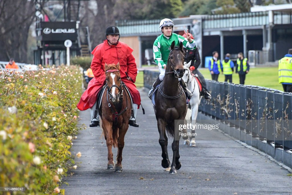 Jordan Childs returns to the mounting yard on Sikandarabad (IRE) after winning the VRC Members Handicap, at Flemington Racecourse on August 11, 2018 in Flemington, Australia.