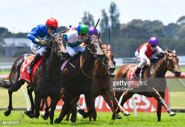 Jordan Childs riding Black and Tan defeats Fred Kersley riding She's Popular in Race 2 during Melbourne Racing at Sandown Hillside on November 29...