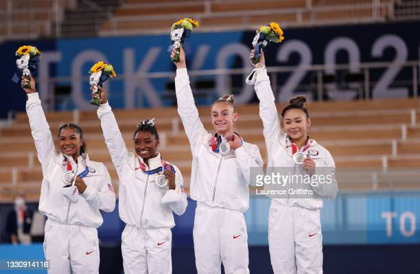 Jordan Chiles, Simone Biles, Grace McCallum and Sunisa Lee of Team United States react on the podium after winning the silver medal during the...