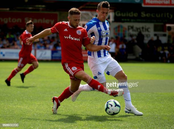 Jordan Clark of Accrington Stanley and Jonathan Hogg of Huddersfiled Town battle for the ball during the preseason friendly between Accrington...