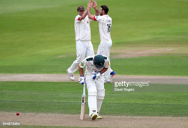 Jordan Clark of Lancashire celebrates after taking the wicket of Michael Lumb during the Specsavers County Championship division one match between...