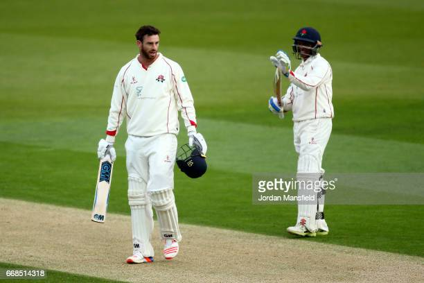Jordan Clark of Lancashire celebrates his century with Shivnarine Chanderpaul of Lancashire during day one of the Specsavers County Championship...