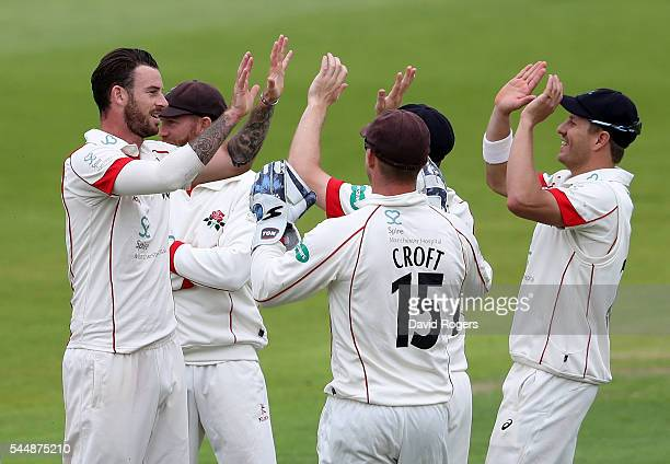 Jordan Clark of Lancashire celebrates with team mates after taking the wicket of Michael Lumb during the Specsavers County Championship division one...