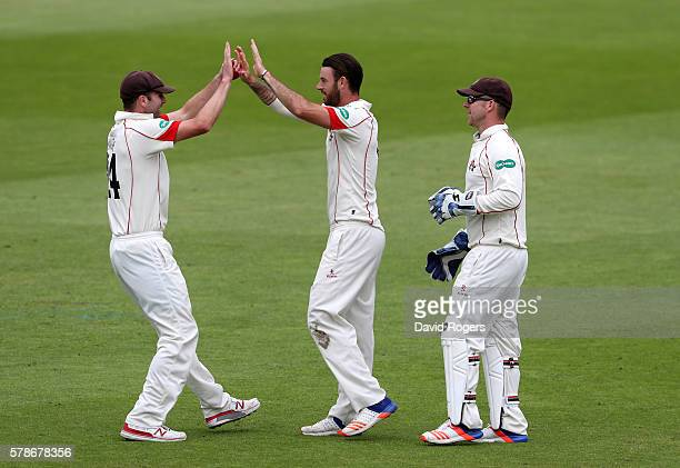Jordan Clark of Lancashire celebrates with team mates after taking the wicket of Brendan Taylor during the Specsavers County Championship division...