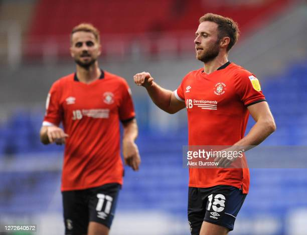 Jordan Clark of Luton Town celebrates after scoring his team's first goal during Carabao Cup Second Round match between Reading FC and Luton Town at...
